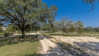 tree lined drive - greenwell springs home for sale