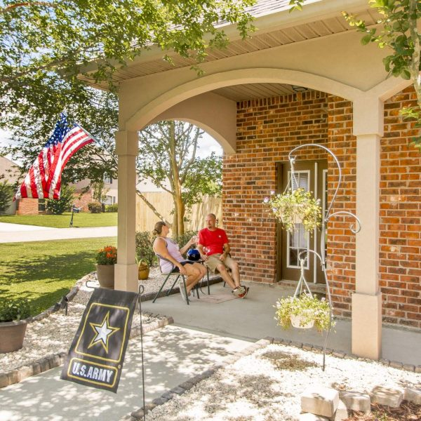 homeowners enjoying the front courtard 37398 cypress place ave dutchtown home for sale