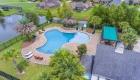 view of neighborhood pool in pelican crossing from above