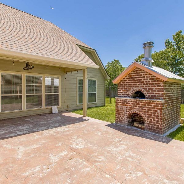 pizza kitchen in backyard of prairieville home for sale